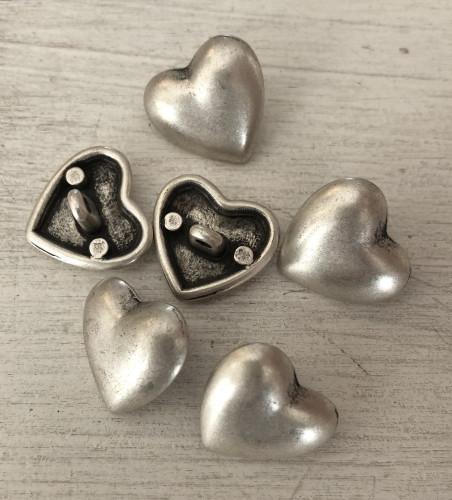 Metallinen kantanappi sileä sydän 18 mm